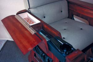 This spectator seat offers a cigar lover a place to store stogies and an ashtray